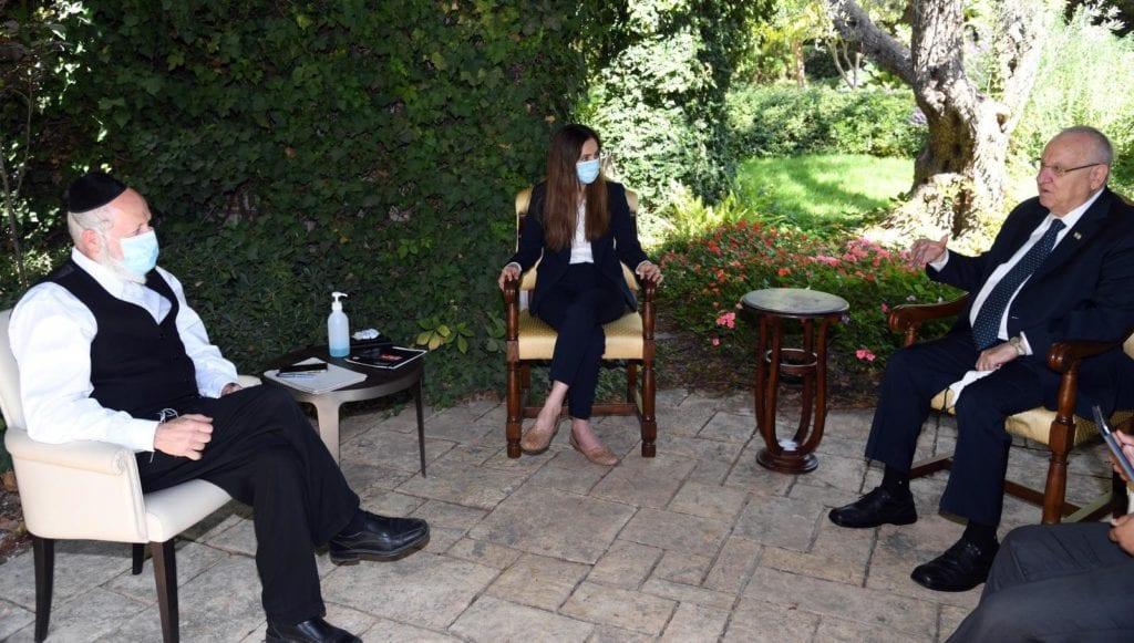 Yehuda Meshi Zahav sitting with President Rivlin and MK Meirav Cohen